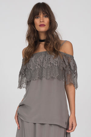 Model is wearing the Julia Lace Silk Off The Shoulder Top in steeple grey with the Hammered Silk Belted Pants in steeple grey.