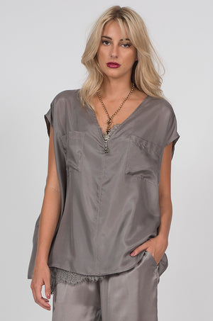 Model is wearing the Habotai Relaxed Silk Tee in steeple grey with the Silk Twill Cuff Pants in steeple grey.