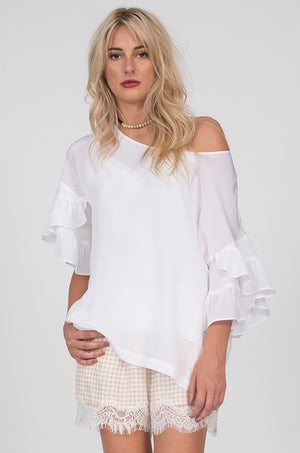 Model is wearing the Ruffle Sleeve Silk Top in white with the Coco Lace Short in dove.