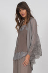 Model is wearing the Coco Silk Lace Kimono in steeple grey, opened, with a Coco Lace Silk Straight Cami and linen wide leg pants.