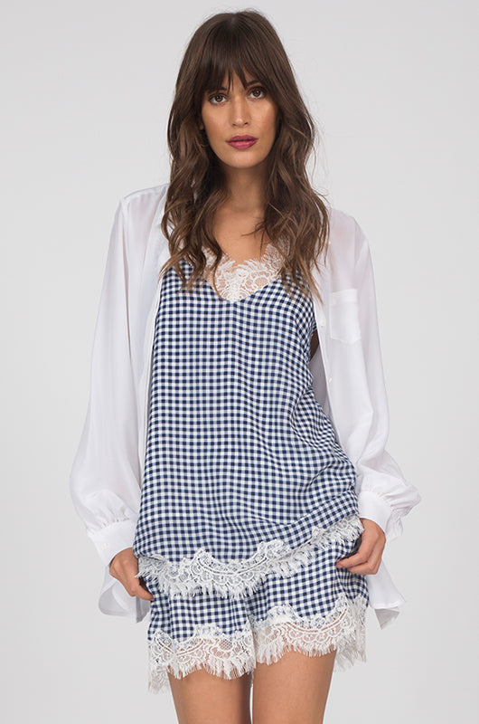 72f1eb73d7b9a Model is wearing the Anne Marie Silk Cami in navy with an open white button  up