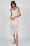 Model is wearing the Anne Marie Silk Dress in sand shell with open toe, nude colored, ankle strap high heels.