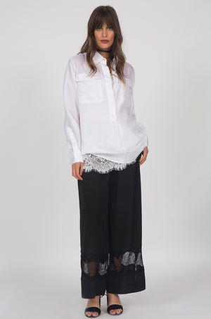 Model is wearing the Julia Lace Silk Pants in black with the Coco Lace Silk Straight Cami in white with the Habotai Pullover Silk Shirt in white on top. Also worn with open toe, ankle strap, black high heels.