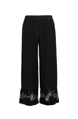 The Julia Lace Silk Pants in black.