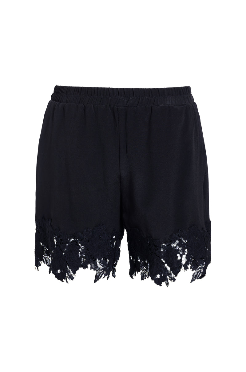 The Julia Lace Silk Shorts in black.