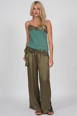 Model is wearing the Hammered Silk Belted Pants in olive with the Marilyn Lace Silk Cami in oil blue olive.
