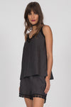 Model is wearing the Linen Capri Shorts in black with the Capri Linen Cami in black.