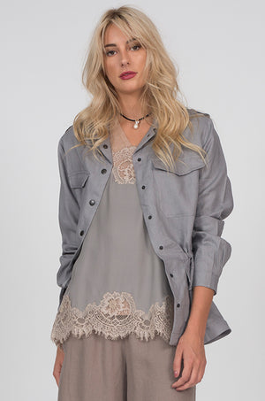 Model is wearing the Linen Army Jacket in steeple grey with the Coco Lace Silk Straight Cami in steeple grey birch and the V-Neck Linen Pocket Tee in sand shell underneath. Also worn with the Wide Leg Linen Belted Pants in steeple grey.