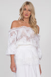 Model is wearing the Suzy Zig Zag Lace Belted Top in white with the Wide Leg Linen Belted Pants in white.