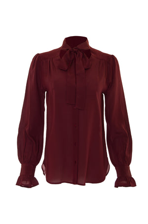 The Silk Front Tie Shirt in burgundy.