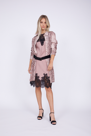 Model is wearing the Python Shirt Dress in muted rose, unbuttoned, over a pink and black lace dress. The dress and shirt are belted together with a thick black belt. Worn with open toe, ankle strap, black high heels.