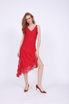 Model is wearing the Modern Coco Dress in fiery red, with reddish orange suede, pointed toe, kitten heels.