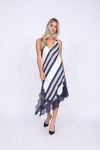 Model is wearing the Bold Stripe Dress in navy with navy suede, pointed toe, low heels.