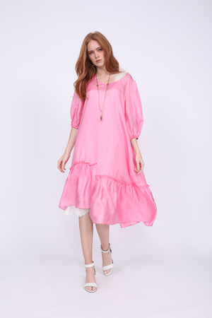 Model is wearing the Maine Peasant Dress in rose, without sash, and with the Megan Coco Dress in white underneath. Also worn with open toe, ankle strap, white high heels.