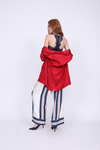 Model is wearing the Hayley Blazer in fiery red with the Lucy Crop Cami in navy underneath. Also worn with the Bold Stripe Pant in navy and blue suede, pointed toe kitten heels.