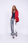 Model is wearing the Bold Stripe Pant in navy with the Lucy Crop Cami in navy and the Hayley Blazer in fiery red. Also worn with blue suede, pointed toe low heels.