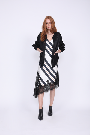 Model is wearing the Bold Stripe Dress in black with the Hayley Bomber Jacket in black, unzipped. Also worn with pointed toe, black ankle boots.