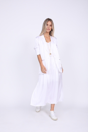 Model is wearing the Hayley Blazer in bright white with the Hayley Tank Dress in bright white. Also worn with white sneakers.