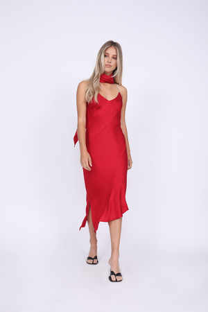 Model is wearing the Aimee Slip Dress in fiery red with matching sash as a scarf. Worn with sandals.