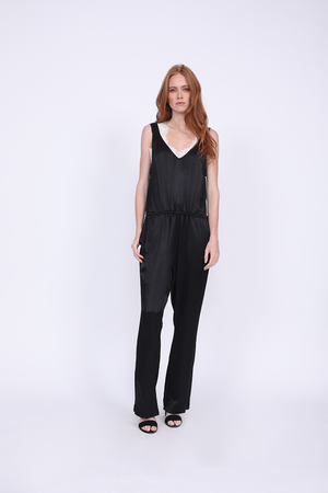 Model is wearing the Hayley Jumpsuit in black with the Megan Camisole in black/dove underneath.