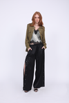 Model is wearing the Python Silk Print Racerback Lace Cami in grey python with the Tencel Western Shirt in dark olive and the Hayley Wide Leg Snap Pant in black, with the snaps undone up to above the knee. Worn with open toe, ankle strap, black high heels.
