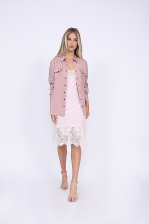 Model is wearing the Tencel Western Shirt in muted rose worn unbuttoned and with the sleeved scrunched, along with the Anne Marie Silk Dress in ballerina pink and off white underneath.