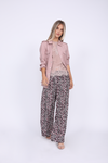 Model is wearing the Tencel Cargo Jacket in muted rose, worn unbuttoned and with the sleeves scrunched up, with the Zoe Coco Cami in muted rose underneath, and the Silk Print Wide Leg Pants in pink animal leopard print.