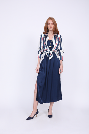 Model is wearing the Bold Stripe Shirt in navy, unbuttoned and cuffed, and tied at the front waist. Worn with the Hayley Tank Dress in navy, and pointed toe, blue suede kitten heels.