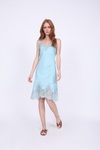 Model is wearing the Coco Bodice Lace Dress in Aqua Powder with flat brown slip in sandals.