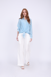Model is wearing the Tencel Cargo Wide Leg Pant in bright white with the Mini Stripe Shirt in baby blue.
