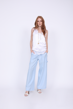 Model is wearing the Stretch Coco Tank Top in bright white with the Tencel Cargo Wide Leg Pant in baby blue.