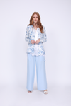 Model is wearing the Provence Shirt in navy provence toile, unbuttoned, with the Coco Lace Silk Straight Cami in white underneath and the Tencel Cargo Wide Leg Pant in baby blue. Also worn with open toe, ankle strap, white high heels.