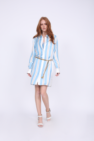 Model is wearing the Bold Stripe Sleeve Dress in baby blue, mostly buttoned, with the Coco Bodice Lace Dress in Aqua Powder underneath and a gold chain used as belt. Also worn with white, open toe, ankle strap high heels.