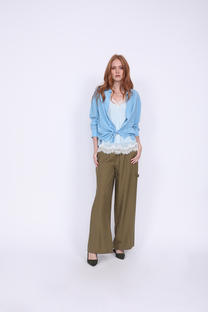 Model is wearing the Anne Marie Silk Cami in baby blue/off white with a baby blue button up shirt, open, cuffed, and tied at the front, and the Tencel Cargo Wide Leg Pant in olive. Worn with emerald green, suede, pointed toe high heels.