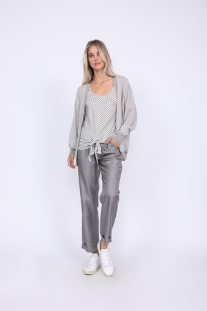 Model is wearing the Mini Stripe Camisole in steeple grey with the Silk Twill Cuff Pants in steeple grey and the Stretch Rib Cardigan in steeple grey. Also worn with white sneakers.