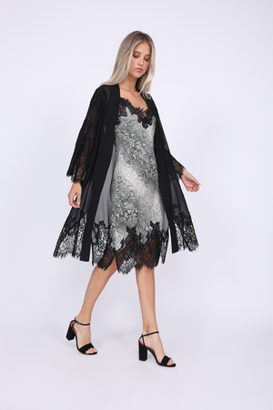 Model is wearing the Python Coco Print Silk Slip Dress in grey python with the Coco Lace Silk Kimono in black. Also worn with open toe, ankle strap, black high heels.