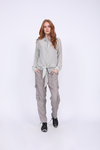 Model is wearing the Mini Stripe Shirt in steeple grey with the Zoe Coco Camisole in ice grey, and the Tencel Cargo Pant in steeple grey with black sneakers.