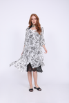 Model is wearing the Provence Peasant Dress in black provence toile with the Coco Bodice Lace Dress in black underneath. Also worn with black, slip in, open toe, flat sandals and a black, white, and gold patterned ascot.