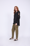 Model is wearing the Lace Cut Out Shoulder Top in black with the Tencel Cargo Pant in olive. Also worn with black, open toe, slip in flat sandals.