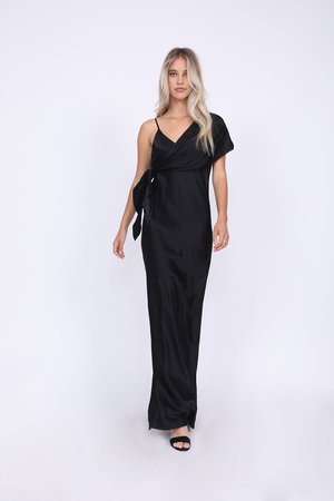 Model is wearing the Hayley Long Slip Dress in black with matching sash worn across one shoulder and tied at the waist.