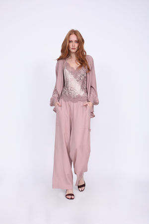 Model is wearing the Python Silk Print Racerback Lace Cami in muted rose python with the Tencel Cargo Wide Leg Pant in muted rose and the Silk Wrap Top in muted rose, worn open. Also worn with open toe, ankle strap, burgundy high heels.