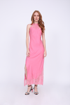 Model is wearing the Zoe Coco Long Dress in rose, with open toe, ankle strap, black low heels with clear colored rhinestones on the toe straps.