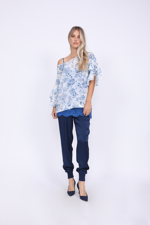 Model is wearing the Provence Ruffle Sleeve Tee in navy provence toile with the Coco Lace Silk Cami in french blue underneath, and the Hayley Jogger in navy. Worn with blue suede, pointed toe, kitten heels.