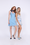 Model is wearing the Provence Camisole in navy provence toile, with the Bold Stripe Shorts in baby blue and baby blue slip in, open toe, flat sandals. Second model is wearing the Coco Bodice Lace Dress in aqua powder with blue suede, pointed toe, kitten heels and a navy blue ascot.