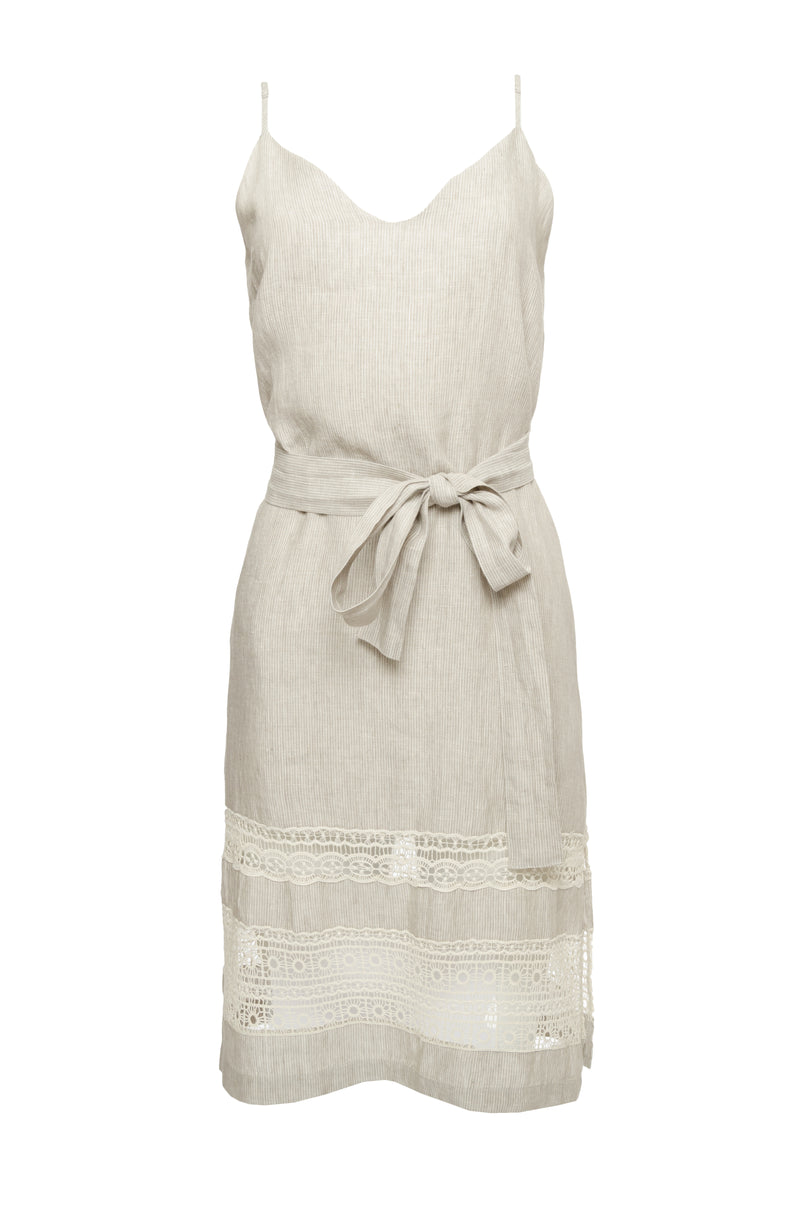 The Capri Linen Slip Dress in birch, with matching sash worn around the waist.