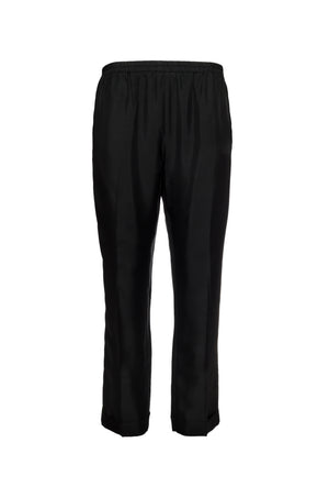 The Silk Twill Cuff Pants in black.