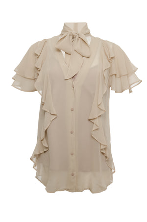 The Ruffle Self-Tie Top in sand shell.