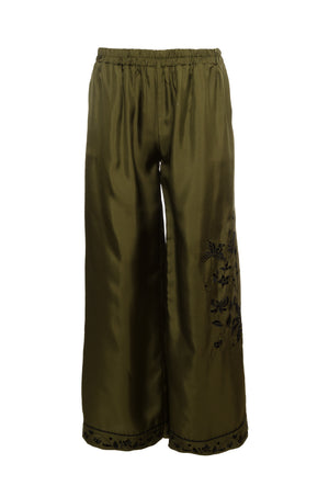 The Emily Silk Embroidered Pants in olive with black embroidery.