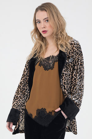 Model is wearing the Animal Print Velvet Ginger Robe Blazer in mocca leopard animal print with the Coco Lace Silk Straight Cami in tobacco/black and the Anastasia Lace Velvet Pants in black.