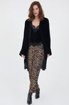 Model is wearing the Animal Print Velvet Ginger Piping Pants with the Lucy Crop Cami in black and the Anastasia Lace Velvet Robe in black. Also worn with black, pointed toe, ankle high heel boots.